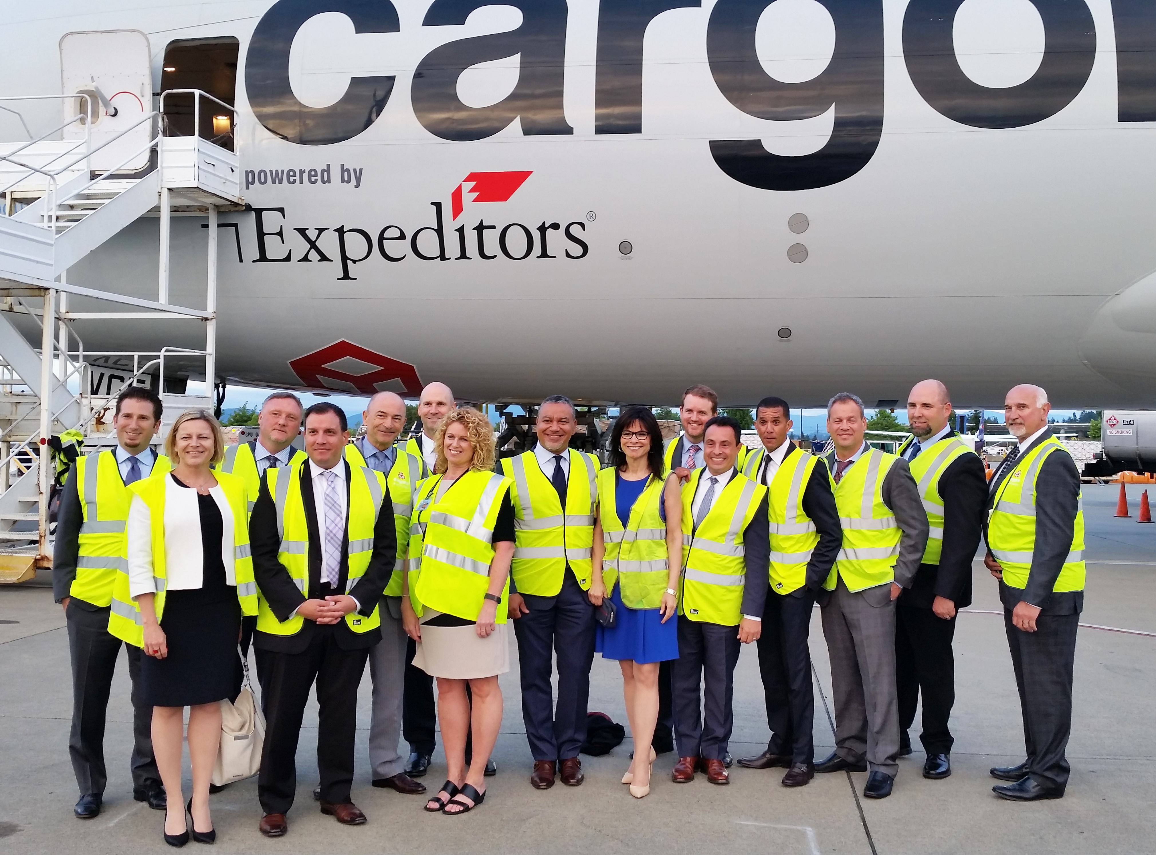 Executives from Expeditors and Cargolux welcome the freighter to Seattle.